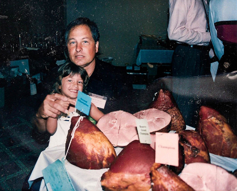 David Dewey and his daughter alongside one of his first national award winning hams